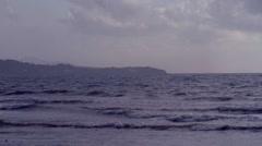 Caribbean waves Beach moody pan to ship on horizon Stock Footage