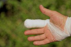 White medicine bandage on human injury hand finger Stock Photos