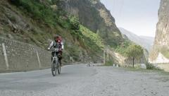 Cyclist on Indian road Stock Footage