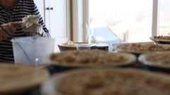 A woman making meat pies for dinner in the kitchen Stock Footage