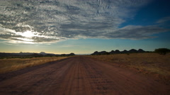 Vanishing point from middle of road, car passes. UHD 4K Stock Footage