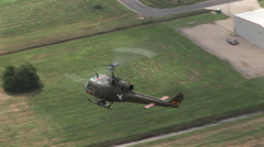 Helicopter gunship flying, shot from above Stock Footage