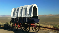 Pioneer Covered Wagon Along Oregon Trail With Prairie in Background Stock Footage
