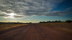 Vanishing point from middle of road, car passes. HD Stock Footage