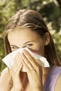 Young woman with allergy Stock Photos