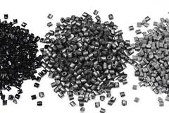 3 heaps of gray polymer - stock photo