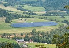 Solar panels in a meadow Kuvituskuvat