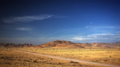LONELY ROAD THROUGH AFRICAN GRASSLANDS UHD 4K - stock footage