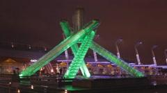 Olympic cauldron green light - holiday evening Stock Footage