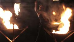 A woman does a fire performance Stock Footage