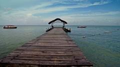 Caribbean blue sky pier glide 03 Stock Footage