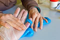 hand physiotherapy to recover a  finger - stock photo