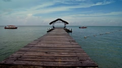 Caribbean blue sky pier glide 01 Stock Footage
