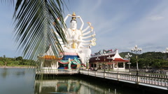 Buddhist statue on a lake Dolly Stock Footage