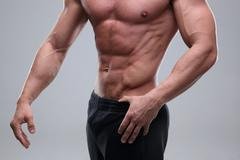 Close up on perfect abs. strong bodybuilder with six pack Stock Photos