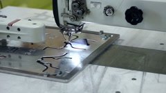 Manufacture of footwear using sewing machine - stock footage