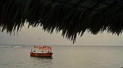 Caribbean boat floats near pier calm water Stock Footage