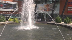 Shopping mall entrance water fountain splashing people motion background, beauty Stock Footage