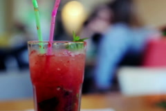 Close up of fruity, strawberry tropical, cocktail with straw NTSC - stock footage