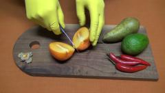 Preparing cutting persimmon, pears and chili pepper Stock Footage