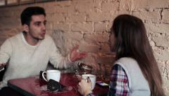 Young couple fight, man late on date with his girlfriend in cafe  HD Stock Footage