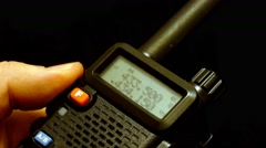 Walkie talkie in hand. On black background Stock Footage