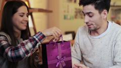 Woman gives her boyfriend a gift during date in cafe  HD - stock footage