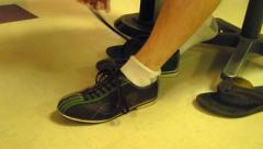 Guy tying bowling shoes Stock Footage