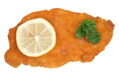 schnitzel chop cutlet with lemon from above - stock photo