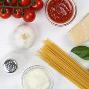 Cooking spaghetti noodles pasta meal ingredients on wooden board Stock Photos