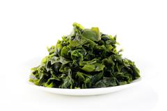 seaweed on white dish - stock photo