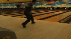 Man throwing bowling ball down alley Stock Footage