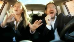 Funny business couple singing while driving car Stock Footage