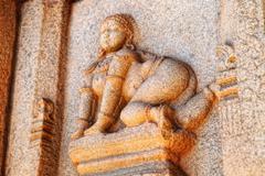 kamasutra stone sculpture - stock photo
