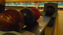 bowling balls racking up on track - stock footage