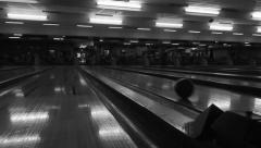 Bowling ball coming down alley Stock Footage