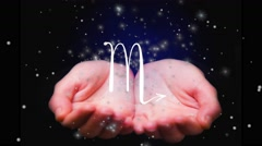 Horoscope Scorpio sign. Female hands  holding zodiac sign for Scorpio. Stock Footage