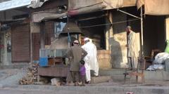 Men at food stall in Karachi, Pakistan Stock Footage