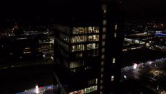 Aerial - Business building with bright illumination office interior at night Stock Footage