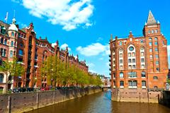 famous old speicherstadt in hamburg, build with red bricks - stock photo