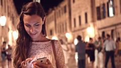 Stock Video Footage of Pretty Young Professional Woman Typing Touchscreen Smartphone Travel App Texting