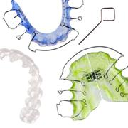 Removable braces, invisible retainer - stock photo