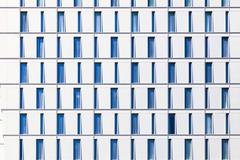 Facade of skyscraper with windows structured in rows with different forms Stock Photos