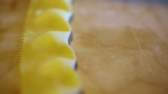 Cutting out ravioli pasta with a ruffled edge pastry wheel. Stock Footage