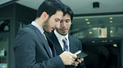 young businessmen using mobile devices to work - stock footage