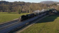 Aerial - Steam engine train crossing the bridge Stock Footage