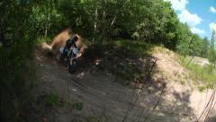 Mx rider on dirt bike takes sandy corner Stock Footage
