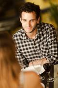 Stock Photo of happy young man in a restaurant