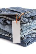 Stock Photo of pile of blue jeans with tag label.
