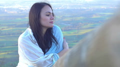 Extremely relaxed young woman leaning against a fence with a breathtaking view b Stock Footage